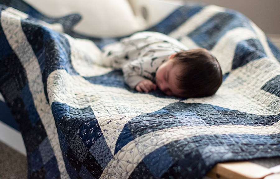 Baby Sleeping on Quilt